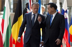 European Council President Donald Tusk, left, walks with Chinese Premier Li Keqiang during arrival for an EU China summit at the Europa building in Brussels on Friday.