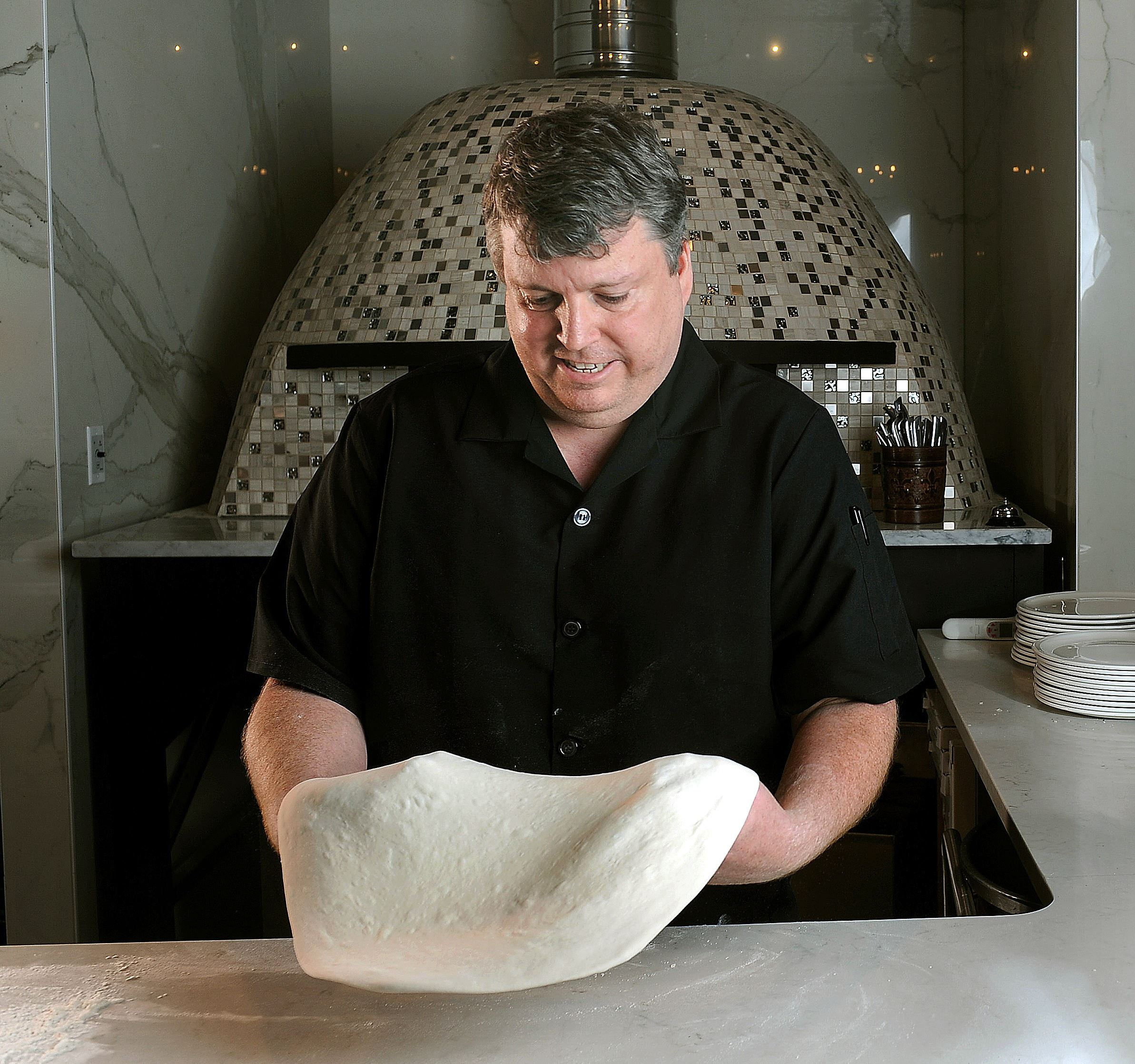 20170601ng-Pizzaiola3-2 Ron Molinaro, executive chef and owner of Il Pizzaiolo in Glenshaw, prepares a high-quality, Neapolitan-style pizza, in his restaurant.