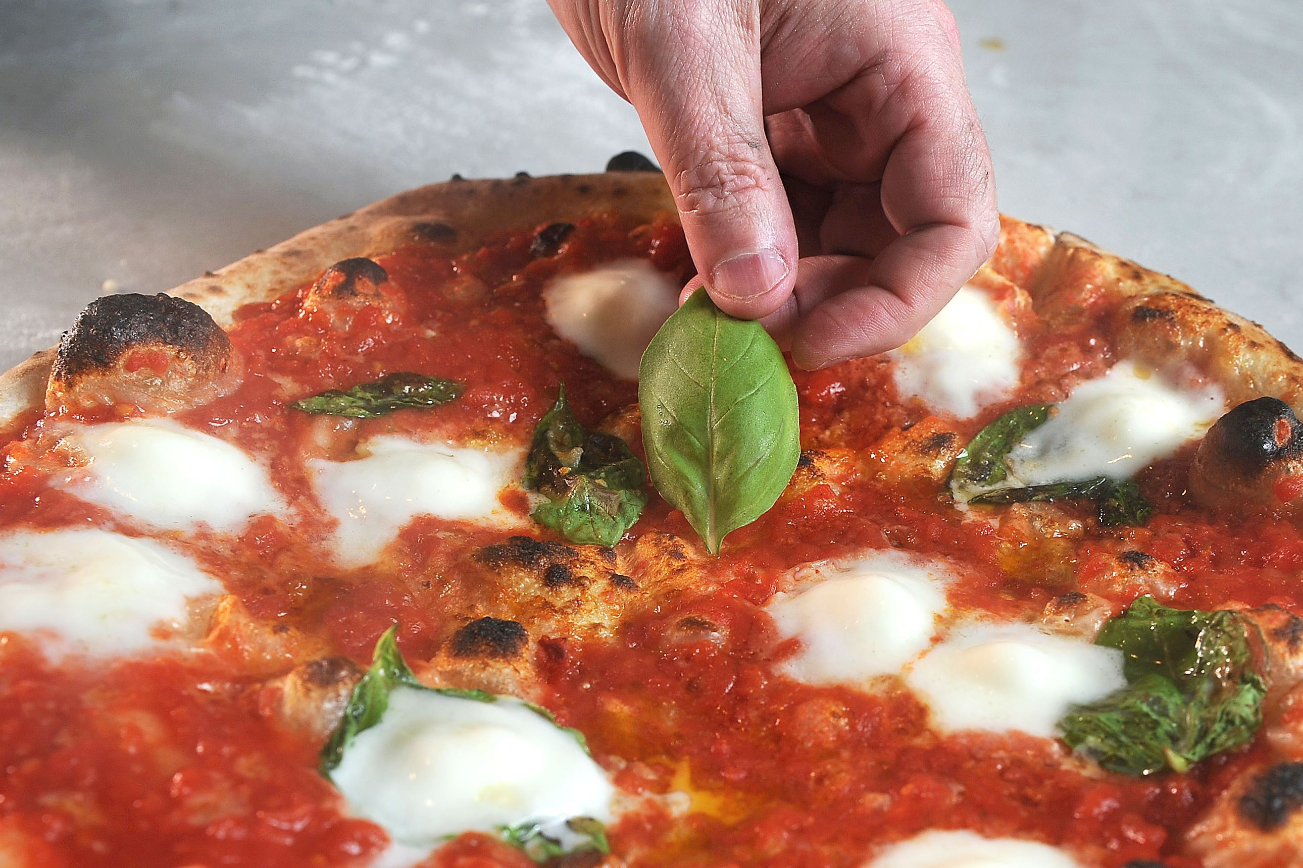 20170601ng-Pizzaiola4-3 Ron Molinaro, executive chef and owner of Il Pizzaiolo in Glenshaw, prepares a high-quality, Neapolitan-style pizza, in his restaurant.
