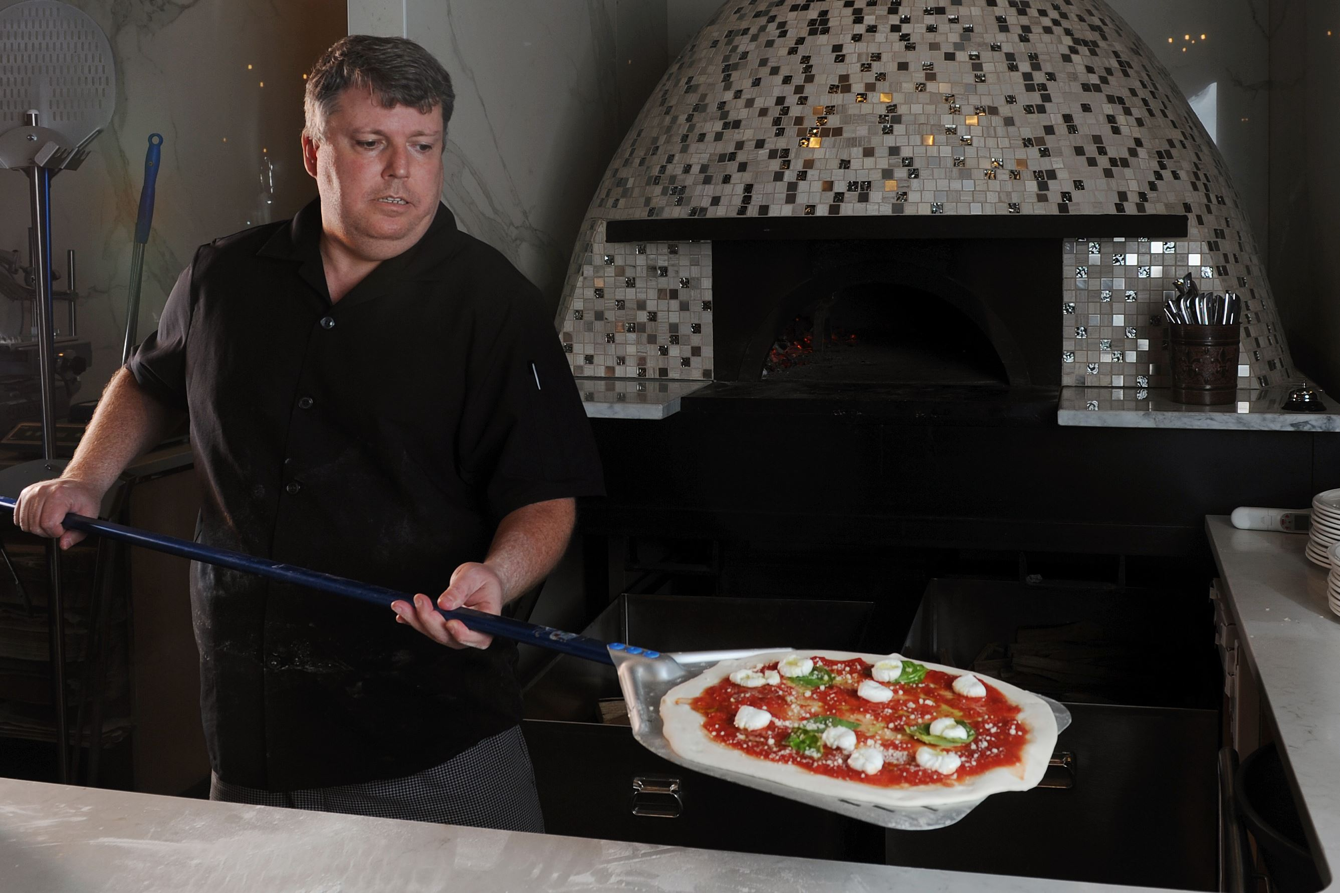 20170601ng-Pizzaiola1 Ron Molinaro, executive chef and owner of Il Pizzaiolo in Glenshaw, prepares a high-quality, Neapolitan-style pizza.