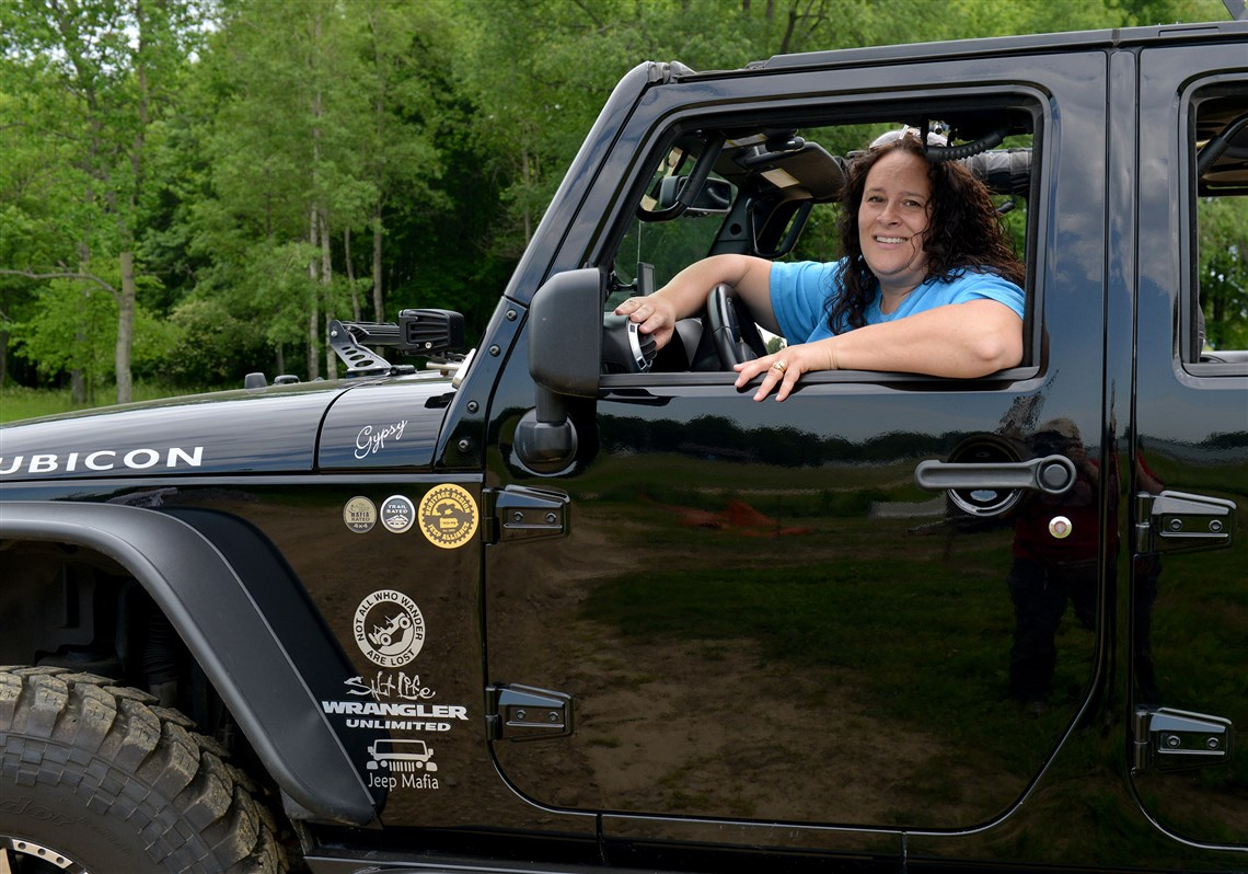 Wendy callahan of sharpsville sits in the 2013 jeep rubicon she uses for commuting and off