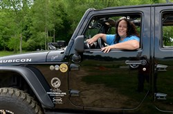 Wendy Callahan of Sharpsville sits in the 2013 Jeep Rubicon she uses for commuting and off-roading. She is on the Babes of Bantam Trail Ride, a course created for women jeepers at the 7th Annual Bantam Jeep Heritage Festival at Cooper's Lake Campground in Slippery Rock.