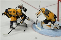 Predators goalie Pekka Rinne makes save on the Penguins' Carter Rowney Saturday in Game 3 of the Stanley Cup final at Bridgestone Arena.