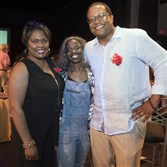 Executive director Janera Solomon, center, with event chairs Gretchen and Bill Generett pose for a photo.