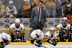 Penguins head coach Mike Sullivan watches as penalties are sorted out near the end of the third period of Game 3 of the Stanley Cup final Saturday.
