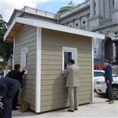 Pennsylvania green building advocates erected two icehouses at the state Capitol in Harrisburg, one built to the state's current energy codes, which were last updated in 2009, and the other built to high-performance energy efficiency standards.