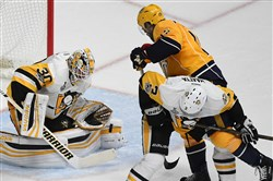 Penguins defenseman Olli Maatta checks Predators Craig Smith off the puck Monday during Game 4 of the Stanley Cup final in Nashville.