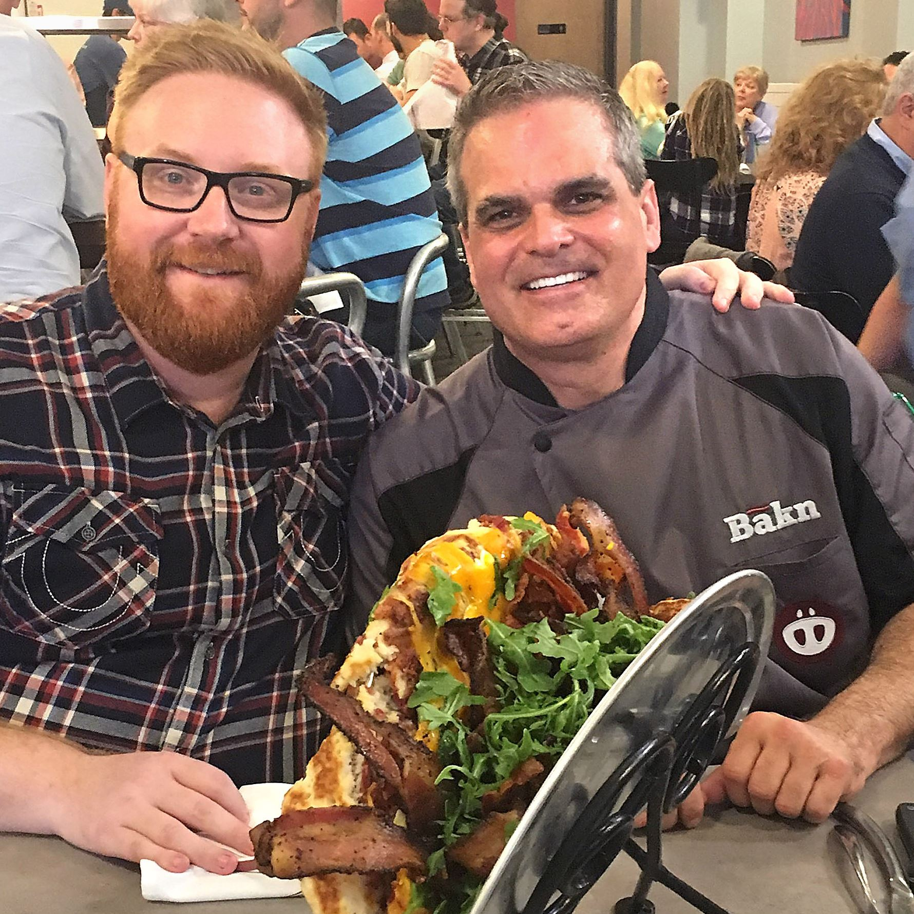 """ginormous bakn Josh Denny, host of Food Network's """"Ginormous Food,"""" with Randy Tozzie, chef and co-owner of Bakn in Carnegie, and a 20-inch taco called Bakn Quake."""