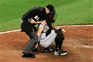 Catcher Francisco Cervelli holds onto umpire Mike Estabrook after taking a foul ball to the mask in the ninth inning June 6 in Baltimore. Cervelli was diagnosed with a concussion.