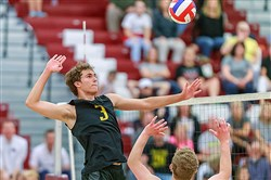 Luke Visgitis is set up for a kill by M.J. Barton in Tuesday night's PIAA semifinal match against Central Dauphin. The Tigers won to advance to the PIAA championship.