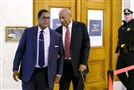 With assistance from his aide, Bill Cosby arrives for day three of his sexual assault trial Wednesday at the Montgomery County Courthouse in Norristown, Pa.