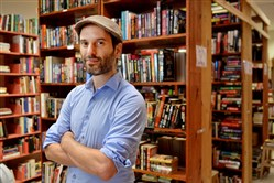 Eric Ackland, owner of Amazing Books & Records, in his Squirrel Hill store.