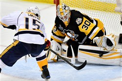 Penguins goaltender Matt Murray stops a shot against the Predators' Craig Smith in the third period of Game 5 of the Stanley Cup final June 8.