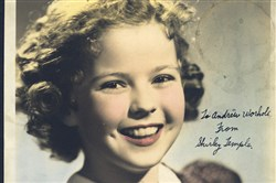 "A signed photo of Shirley Temple from ""Andy Warhol: Stars of the Silver Screen."""