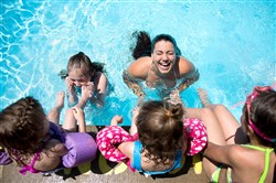 Mollie Sweeney, top right, laughs as she plays in the pool Friday with the girls she babysits, from left to right, Alyssa Ionadi, 3, Hailey Ionadi, 7, Jordyn Ionadi, 3, and Madison Ionadi, 8, at Plum Aqua Club in Plum. This summer will be the pool's final season due to a nearby turnpike project that eliminate access to the club's entrance.