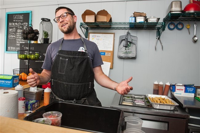 Zack Shell of Point Breeze talks as he prepares for a soft opening at his new restaurant, Baby Loves Tacos.