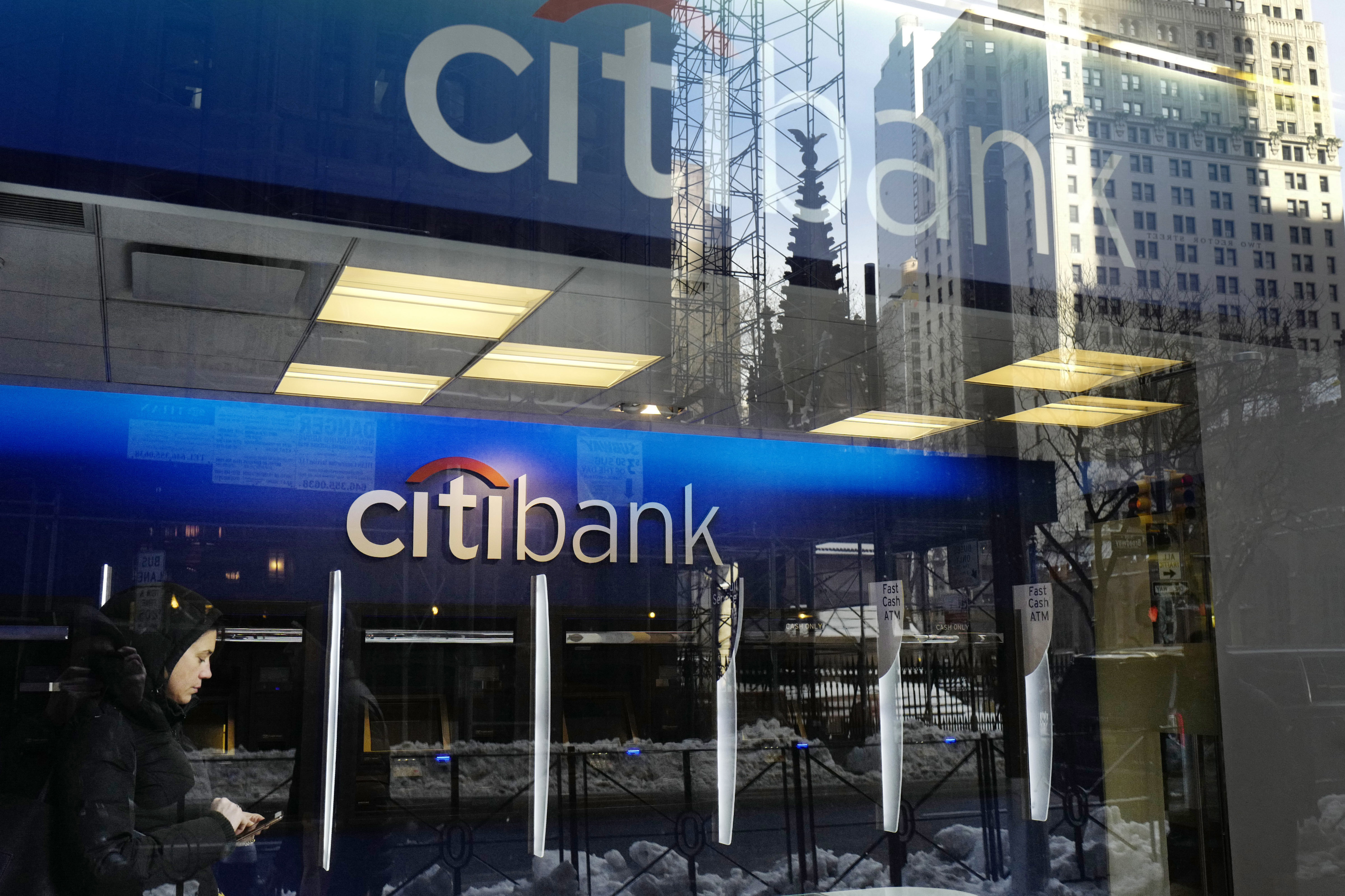 """Climate Companies Q A-1 FILE - In this Thursday, March 16, 2017, file photo, a customer enters a Citibank branch, in New York. President Donald Trump's decision to abandon the Paris climate agreement will have different impacts on different US companies, depending on what they make and whether they do business overseas. Citibank, which had urged Trump to keep the U.S. in the accord, said Friday, June 9, that it would """"remain very focused on our own efforts to protect the environment,"""" including its commitment to finance $100 billion in clean energy, infrastructure and technology projects. (AP Photo/Mark Lennihan, File)"""