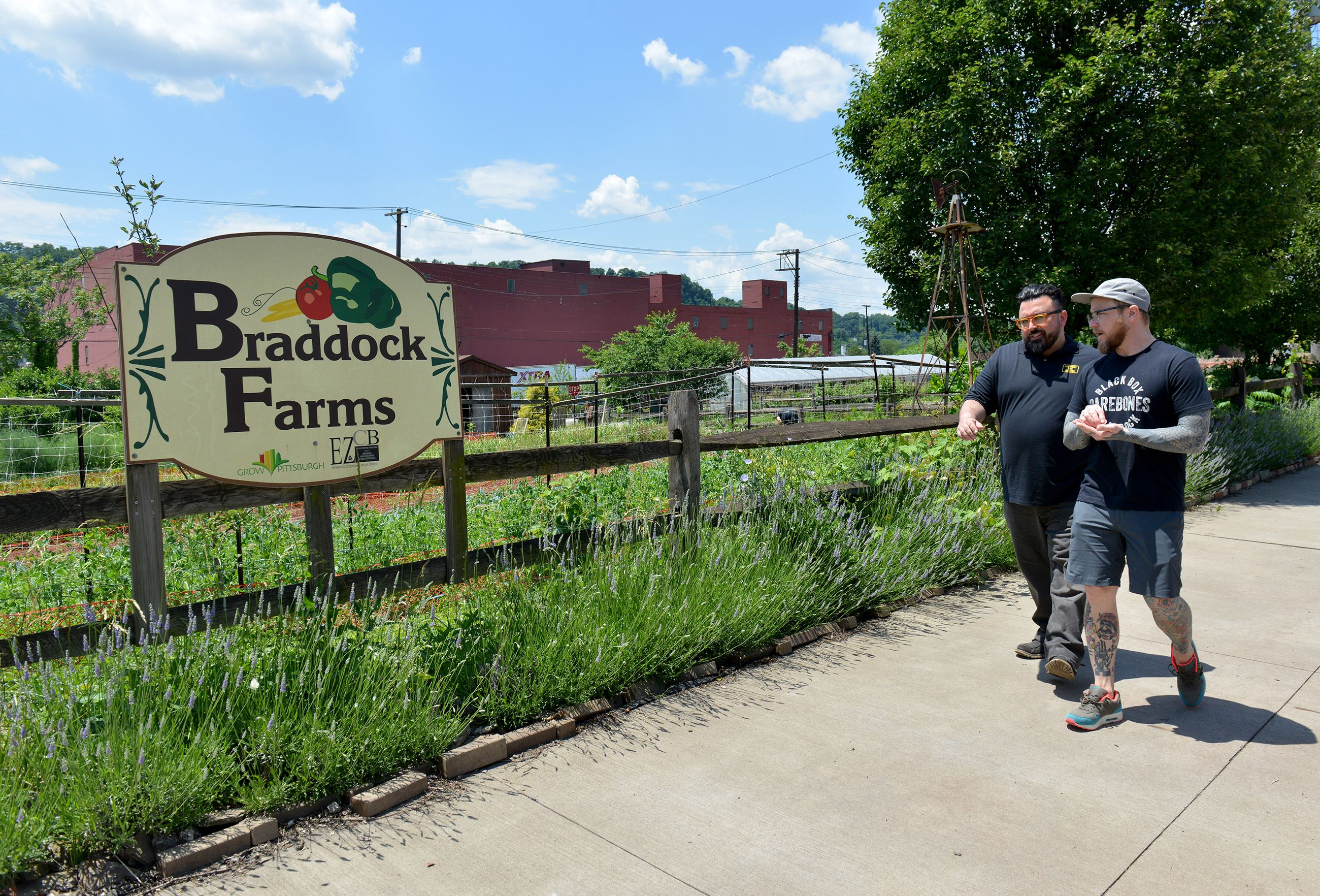 20170609ppSuperiorMotors5LOC-4 General manager Chris Clark, left, and owner Kevin Sousa walk back to their restaurant after visiting Braddock Farms down the street from the restaurant.