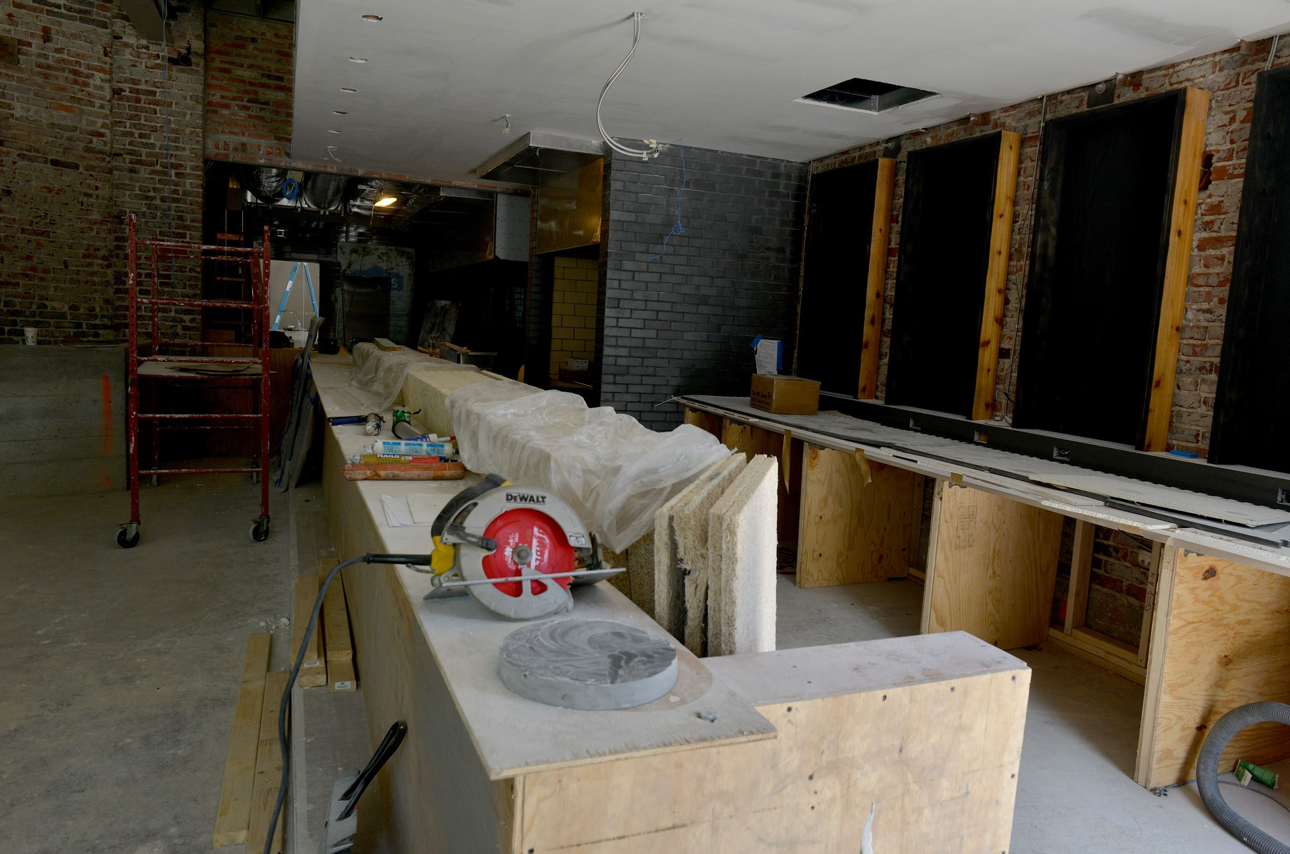 20170609ppSuperiorMotors6LOC-5 The bar, just off the main dining area, is to be covered in black steel.