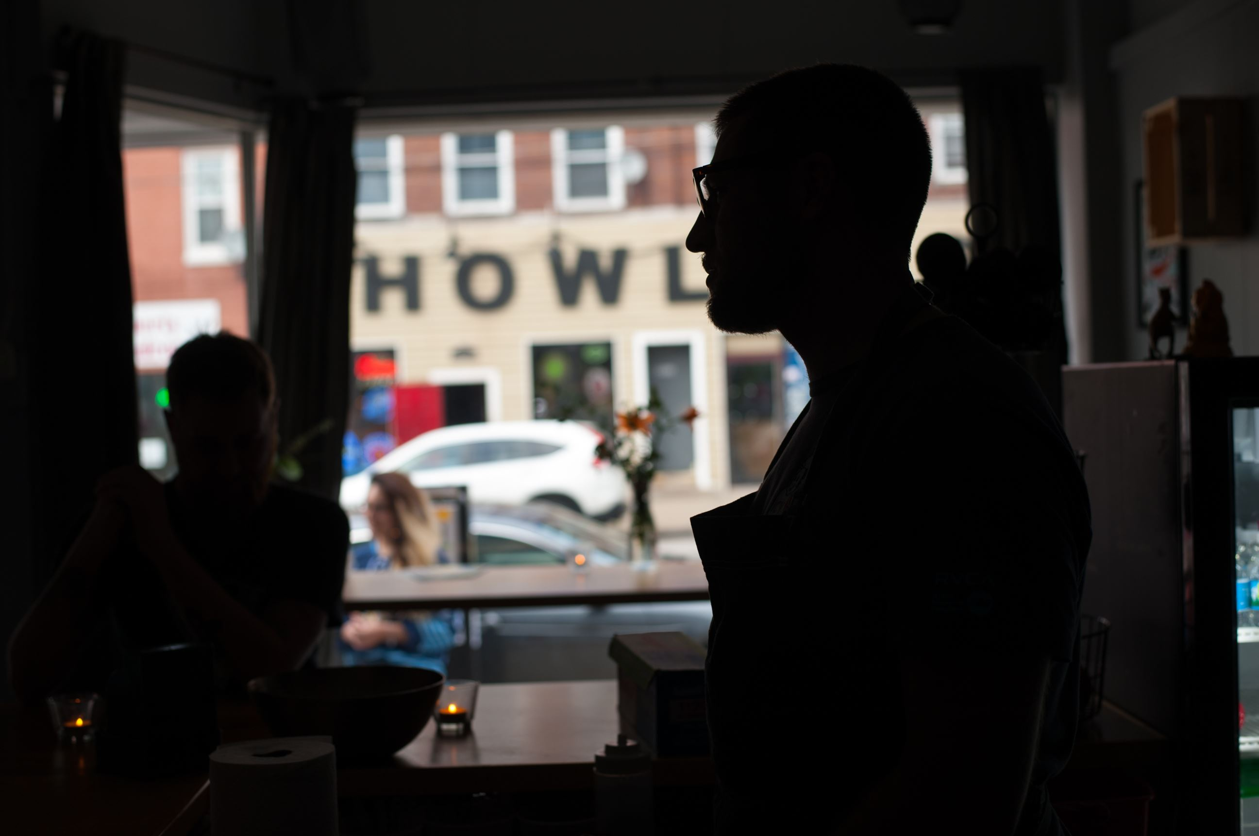 20170608smsTacos05-4 Zack Shell of Point Breeze is silhouetted against the buildings of Liberty Ave. at his new restaurant, Baby Loves Tacos in Bloomfield.