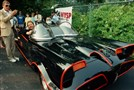 Adam West, left, stands beside the old Batmobile driven by owner Scott Chinery in Philadelphia.