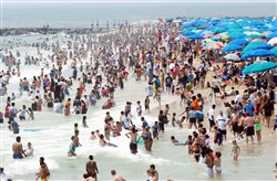 Thousands take a dip in the Atlantic Ocean.