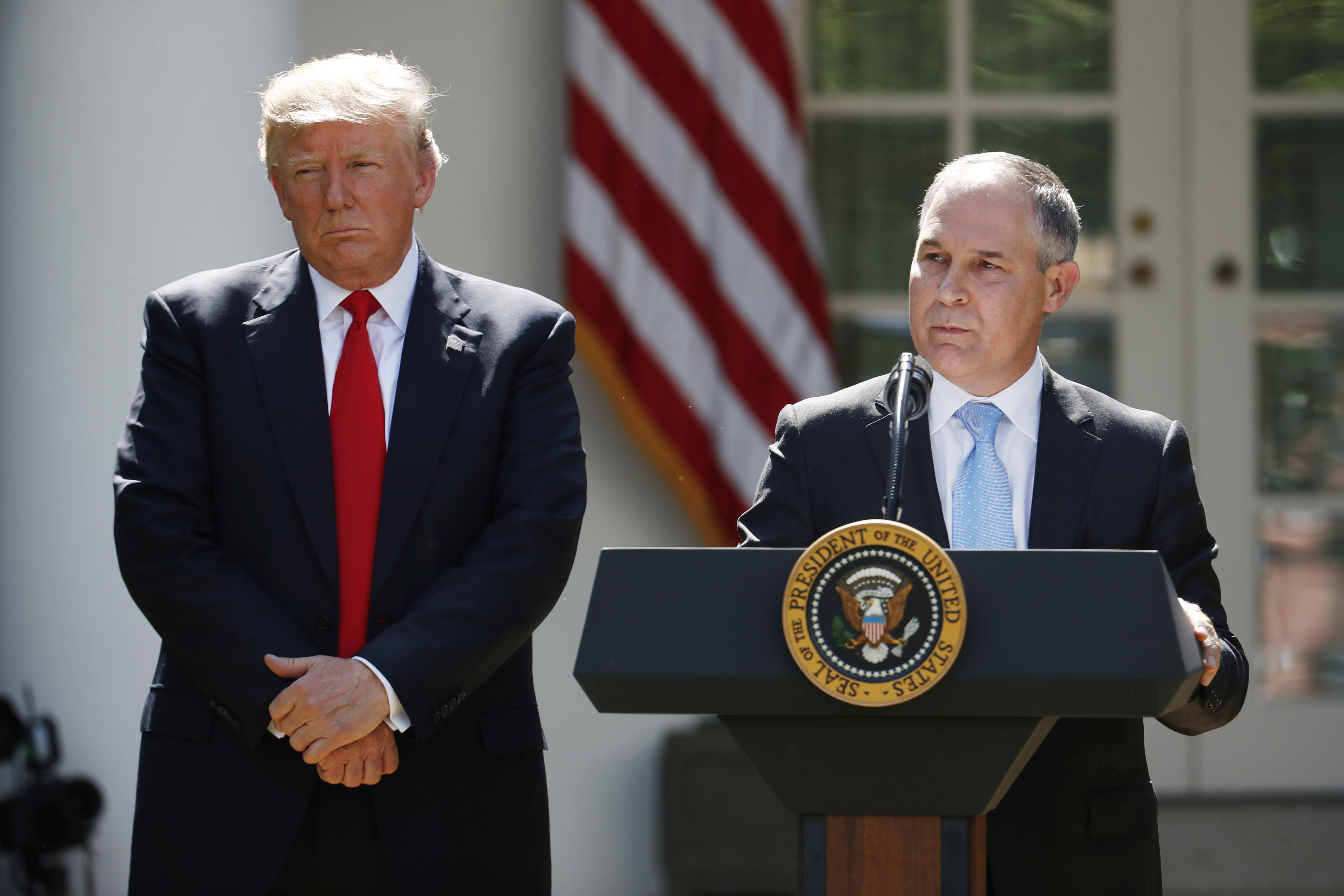 Trumps Climate War-1 FILE - In this June 1, 2017 file photo, President Donald Trump listens as EPA Administrator Scott Pruitt speaks about the U.S. role in the Paris climate change accord in the Rose Garden of the White House in Washington. Trump's recent decision to pull the United States from the international climate deal reached in Paris was but the latest in a rapid-fire series of moves that would weaken or dismantle federal initiatives to reduce carbon emissions, which scientists say are heating the planet to levels that could have disastrous consequences. (AP Photo/Pablo Martinez Monsivais)