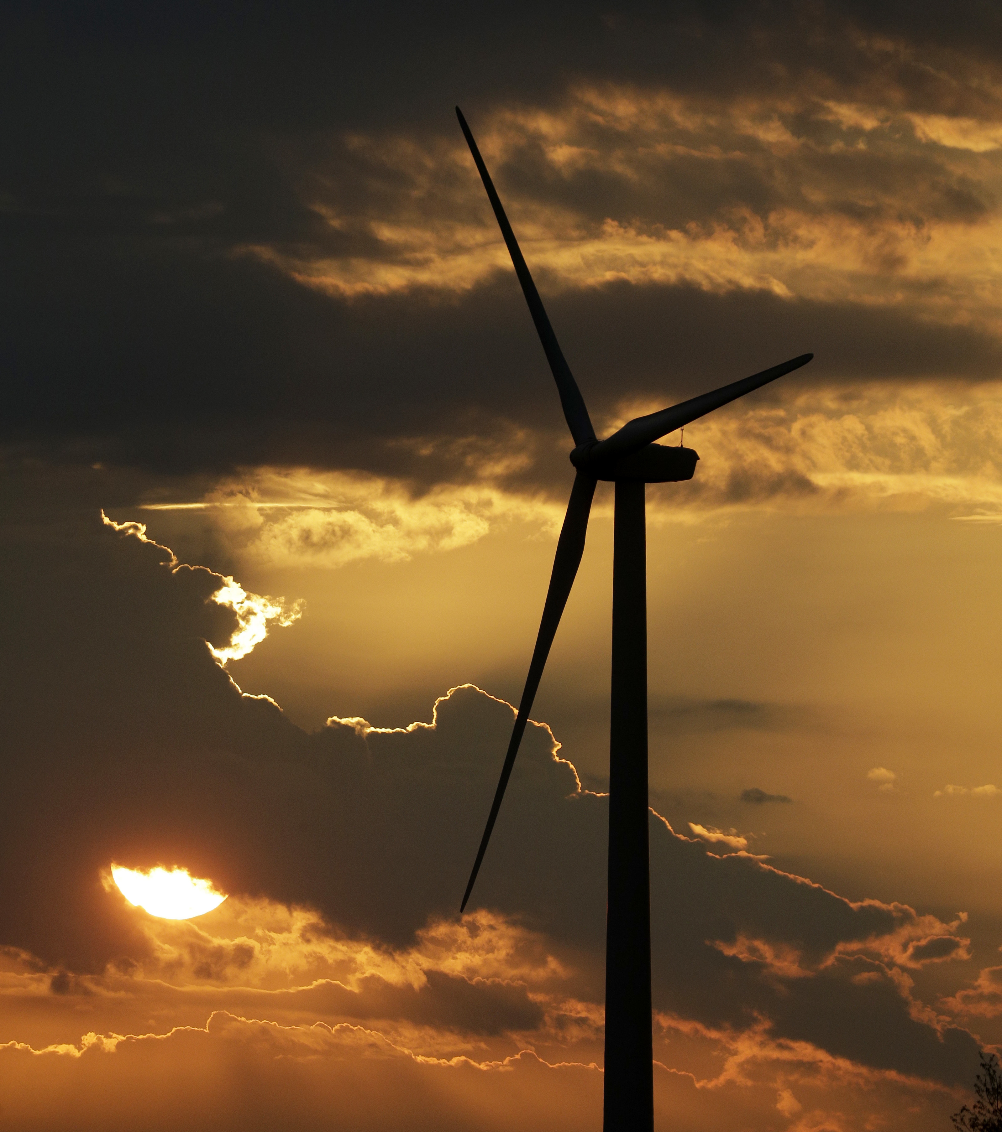 Trumps Climate War-2 FILE - In this June 1, 2017 file photo, a wind turbine, part of the Lost Creek Wind Farm, is silhouetted against the setting sun near King City, Mo. President Donald Trump's recent decision to pull the United States from the international climate deal reached in Paris was but the latest in a rapid-fire series of moves that would weaken or dismantle federal initiatives to reduce carbon emissions, which scientists say are heating the planet to levels that could have disastrous consequences. . (AP Photo/Charlie Riedel)