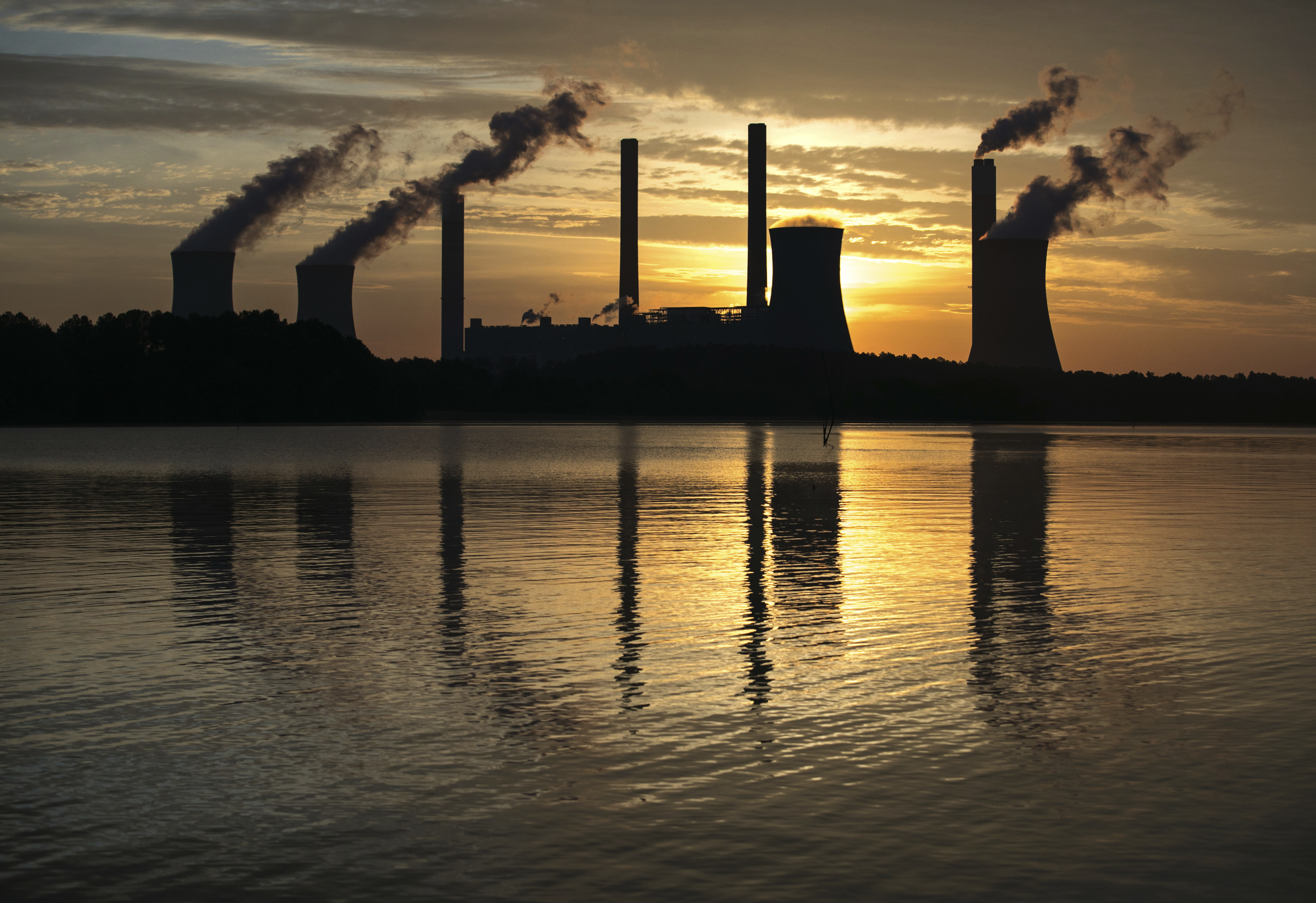 Trumps Climate War-3 FILE - In this June 3, 2017 file photo, the coal-fired Plant Scherer, one of the nation's top carbon dioxide emitters, stands in the distance in Juliette, Ga. President Donald Trump's recent decision to pull the United States from the international climate deal reached in Paris was but the latest in a rapid-fire series of moves that would weaken or dismantle federal initiatives to reduce carbon emissions, which scientists say are heating the planet to levels that could have disastrous consequences. (AP Photo/Branden Camp)