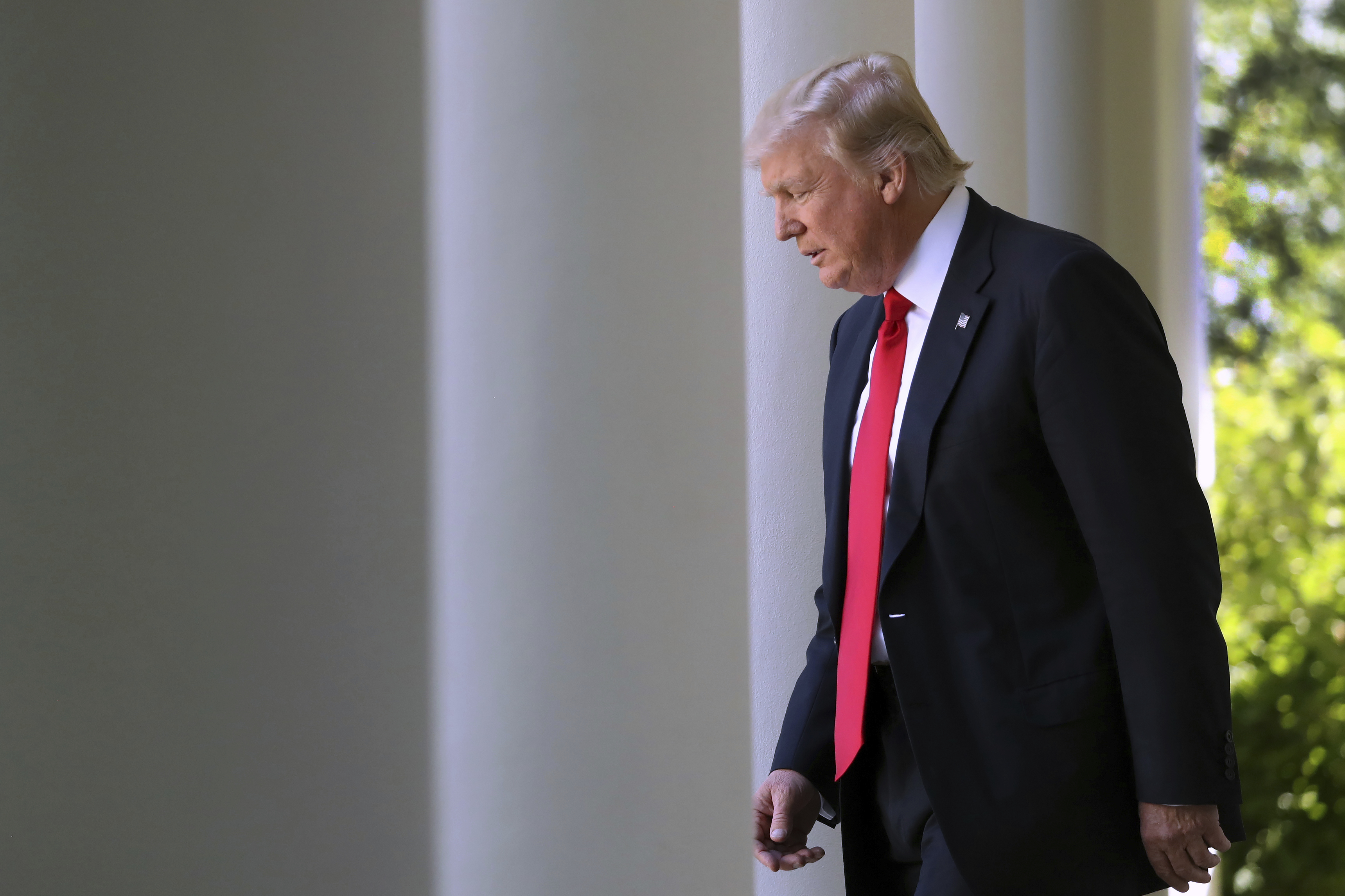 Trumps Climate War-4 FILE - In this June 1, 2017 file photo, President Donald Trump arrives in the Rose Garden of the White House in Washington, to speak about the US role in the Paris climate change accord. Trump's recent decision to pull the United States from the international climate deal reached in Paris was but the latest in a rapid-fire series of moves that would weaken or dismantle federal initiatives to reduce carbon emissions, which scientists say are heating the planet to levels that could have disastrous consequences. (AP Photo/Andrew Harnik)