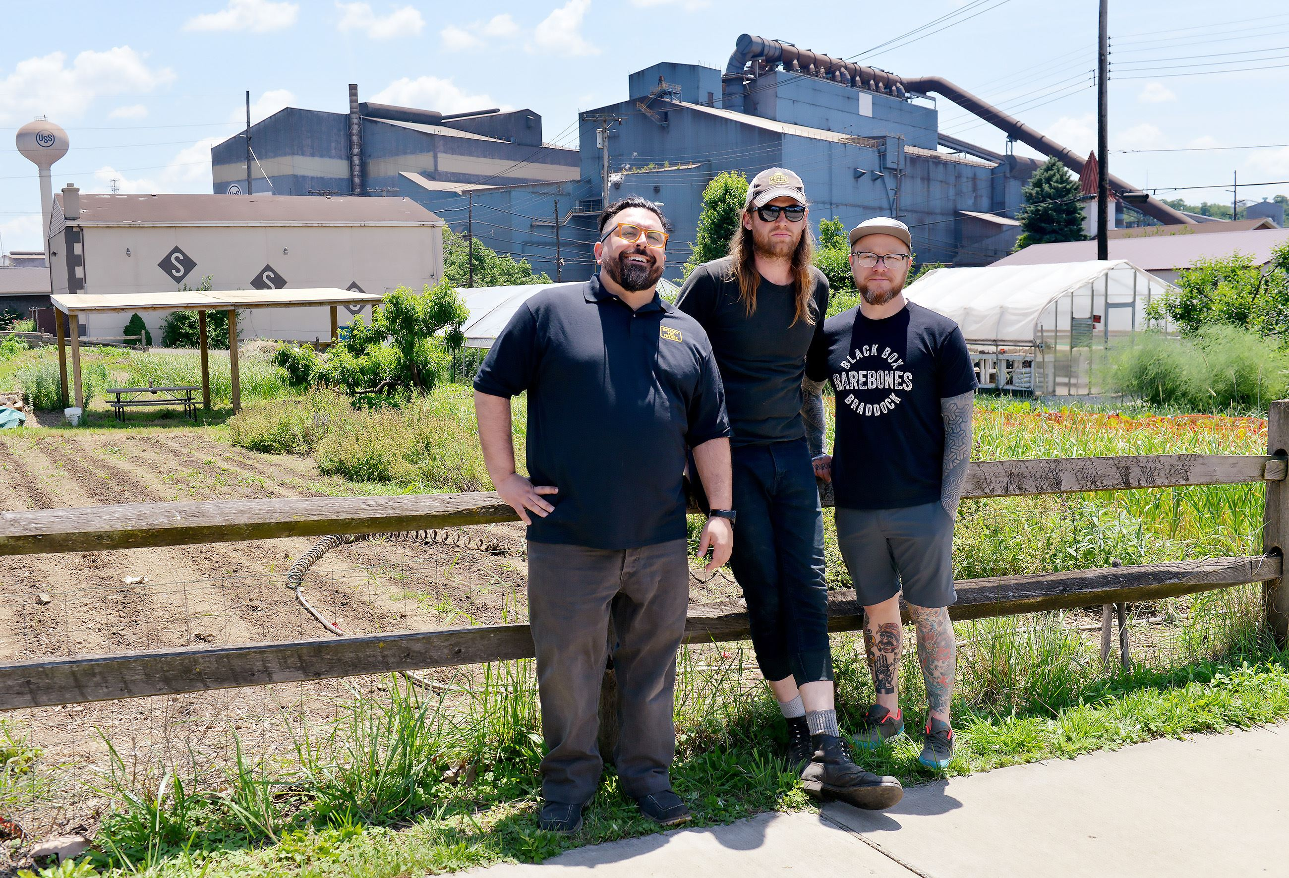 20170609ppSuperiorMotors4LOC From the left, Chris Clark , general manager of Superior Motors with Marshall Hart , the head of Braddock Farms and Kevin Sousa, owner of Superior Motors at the organic farm in Braddock that will be supplying the restaurant with fresh produce.