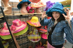 Alexandra Morel of Fox Chapel tries on a hat Sunday during the final day of the Three Rivers Arts Festival.