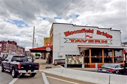 The Bloomfield Bridge Tavern sits at the corner of Liberty Avenue and the Bloomfield Bridge.