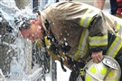 Pittsburgh Battalion Fire Chief Gregory Lowman cools down after battling a two-alarm blaze at 952 Beech Avenue on the North Side on Monday. The fire began on the roof of the three-story building and spread to the top floor.