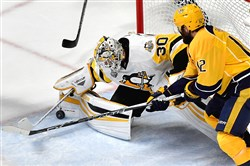 Penguins goaltender Matt Murray stops a shot by Predators center Mike Fisher in the first period of Game 6 of the Stanley Cup final Sunday at Bridgestone Arena in Nashville.