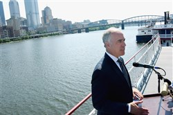 Sen. Bob Casey, D-Pa., addresses a group from the deck of a Gateway Clipper ship on Monday.