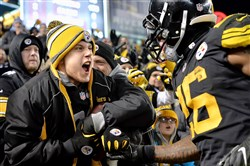 Le'Veon Bell gives a fan the ball after scoring a touchdown last season against the Ravens at Heinz Field.