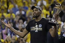 Golden State Warriors forward Kevin Durant holds the Bill Russell NBA Finals Most Valuable Player Award Monday after Game 5 of the series between the Warriors and the Cleveland Cavaliers in Oakland, Calif.