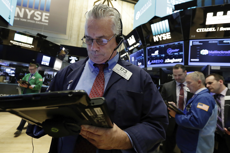 Stocks slide as investors seek safety after weak sales data for 14 wall street 23rd floor