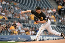 Chad Kuhl delivers a pitch against the Rockies on June 14.