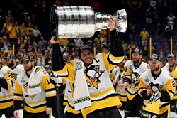 Penguins Sidney Crosby takes a second lap with the Stanley Cup after defeating the Predators in Game 6 of the Stanley Cup final, Sunday at Bridgestone Arena in Nashville.