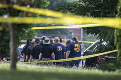 Members of the FBI Evidence Response Team document the scene at Eugene Simpson Stadium Park on Tuesday after the  shooting that critically injured House Majority Whip Steve Scalise.