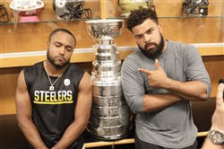Mike Mitchell, left, and Cam Heyward pose with the Stanley Cup Thursday at the Steelers' facility on the South Side.