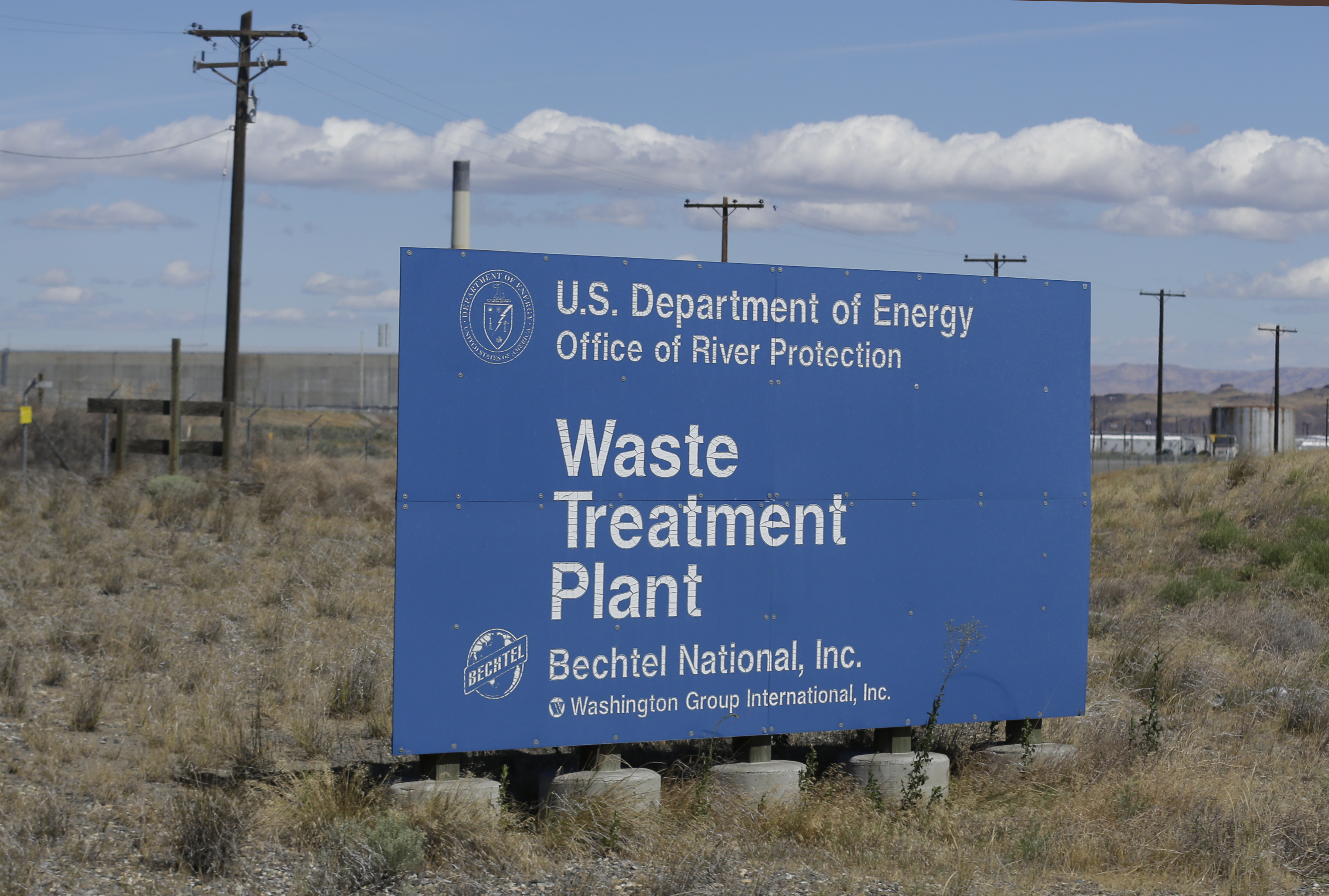Hanford Nuclear Waste-3 In this photo taken July 11, 2016, a sign for a waste treatment plant on the Hanford Nuclear Reservation is shown near Richland, Wash. The U.S. Energy Department's top official at Washington state's severely contaminated nuclear reservation says future accidental nuclear radiation releases are likely because of aging site infrastructure and inadequate cleanup funding. Hundreds were evacuated May 9, 2017 when the roof of a 1950s rail tunnel storing a lethal mix of waste from plutonium production collapsed. Tests show no radiation was released. (AP Photo/Ted S. Warren)