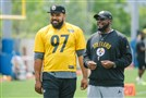 Pittsburgh Steelers coach Mike Tomlin watches practice with Cameron Heyward at the Steelers facility on the South Side on Thursday. Heyward missed half of the 2016 season with an injury.