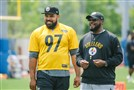 Mike Tomlin and Cameron Heyward watch Steelers practice June 15 on the South Side.