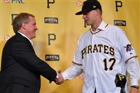 General manager Neal Huntington shakes hands with first-round pick Shane Baz after Baz signed a contract with the Pirates June 16. The high school pitcher will start his career in the Gulf Coast League.