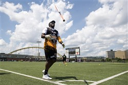Eric Taylor flips his bat during Antonio Brown's celebrity softball event in June at Highmark Stadium on the South Side.