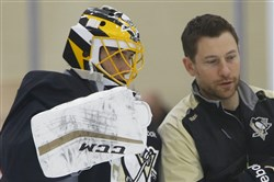 Marc-Andre Fleury talks with goaltending coach Mike Bales.
