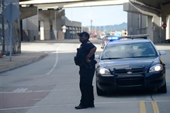 An Allegheny County Sheriff's deputy blocks the busway as jurors in the Cosby sexual assault trial are picked up Saturday, June 17, 2017, in the Strip District, Pittsburgh.